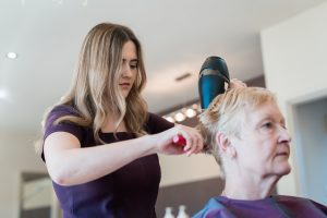 Hairdresser drying short hair